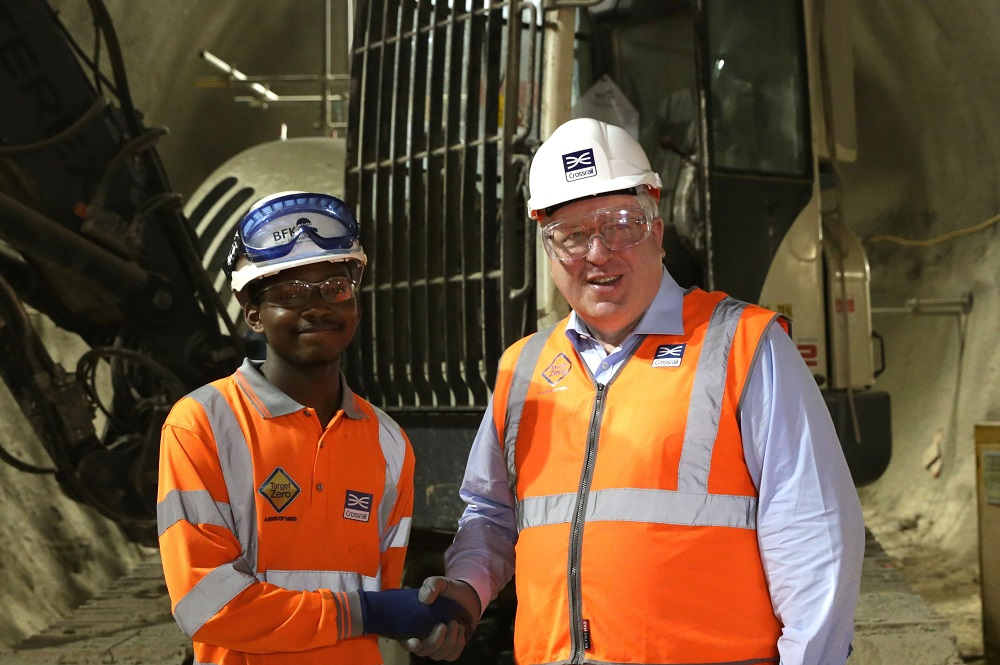Jordan Malcolm-Taylor (left), 100th BFK apprentice and Patrick McLoughlin, Transport Secretary (right)