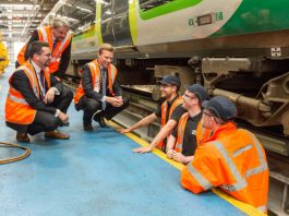 L-R Dan Walker, Mike Townsend and Kirk Trewin with apprentices at Kings Heath depot in Northampton