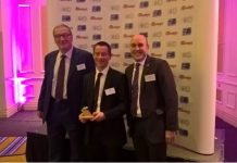 L-R Adrian Shooter of Vivarail presents an award to London Midland's Paul Dowdle and Steve Helfet
